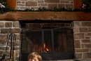 How to Put a Garland Up on a Brick Fireplace
