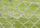 Trimming a Lawn With a Chain-Link Fence
