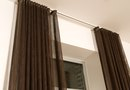 How to Hang a Long Curtain From the Ceiling