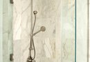 How to Remove Glued Vinyl Shower Sheets From Concrete Walls