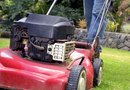 How to Tighten the Belt on a Self-Propelled Troy-Bilt Mower