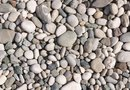 How to Landscape a Gravel Seating Area in the Yard
