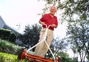 How to Raise a Mower or the Wheels to Cut High With a Push Mower