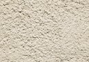 How to Put Decorative Stucco & Rocks on an Exterior Concrete Brick Wall
