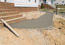 How to Pour a Level Concrete Pad on Unlevel Ground