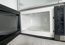 How to Remove & Install a Microwave Above a Range