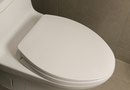 How to Stop an Elongated Toilet Seat From Slipping