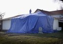 How to Use a Tarp to Slow a Leaky Roof
