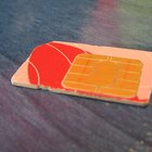 Inserting a SIM card into your LG Neon allows you to use your wireless subscription service.