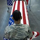 Who gets flag-draped caskets?