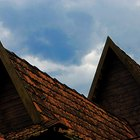 Look for missing shingles on roofs to spot potential problems.