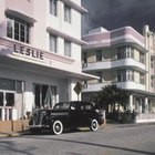 Smooth, curved edges, common in art deco style can be seen on both the buildings and the car.