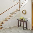 Stairs in a private residence need only have a railing on one side.