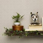 Small books, plant and decorative items combine for a country-style display.