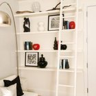 Brightly colored accessories pop against white shelves.