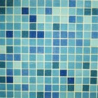 Blue or green tile looks right in a seaside-themed bathroom.