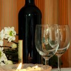 Flowers, wine and glassware add elegant touches to a candle-lit table.