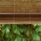 You can soften a bright color scheme with neutral bamboo blinds.