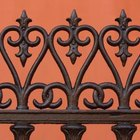 Affix old wrought iron fencing to painted drywall for style and privacy.