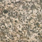 New Caledonia granite is one good option to pair with maple cabinetry.