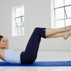 Holding Your Body Up & Lifting Your Legs Up and Down During Stomach Crunches
