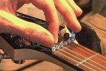 how to fix a broken acoustic guitar string ehow. Black Bedroom Furniture Sets. Home Design Ideas