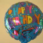 Send a birthday party care package, complete with balloons.