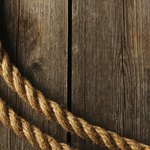 Rope on wood background