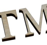 An unregistered mark may be followed by a TM symbol, and once registered, the TM symbol is followed by an ® symbol.