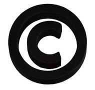 The copyright symbol is useful but no longer required in the United States.