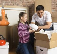 Father and child packing to move