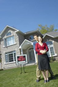 You can usually sell your house during bankruptcy -- with the court's consent.