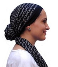 This head scarf style adds flowing  length without need for  a hair brush. Maintenance-free elegance.