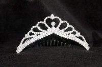 Tiaras like this one that reflect the shape of the head are perfect for loose hairstyles