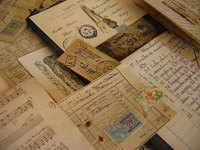 Antique papers, photos and cards should be handled carefully.