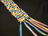 This scarf, made from one rainbow-colored ribbon, has a festive confetti look.