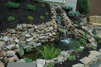 A completed hillside water garden with waterfall