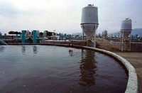 Fish farming tank, showing feeding silo and oxygen jets