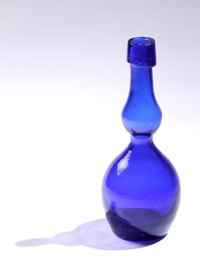 Glass bottles can be transformed into original votives and vases.