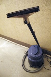 The shop vacuum can aid in dust collection when using power tools.