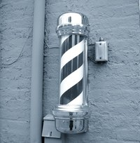 Painting a spiral on a pole can be done with only a few common painting tools.