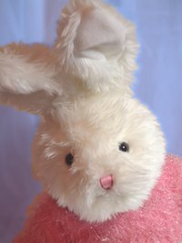 Create a cute bunny pinata using paper mache.