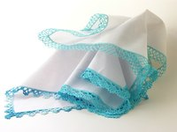 Add a colorful lace trim to brighten up a plain handkerchief.
