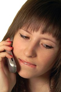 Poor posture while talking on the phone can contribute to neck pain.