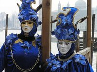 Carnival masks are typically paired with dazzling costumes.