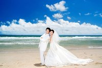 The beach is a spectacular backdrop for an memorable but cheap wedding.