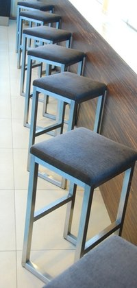 Bar stools can be bought or made inexpensively.