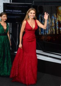 A fitted red dress shows off actress Sofia Vergara's hourglass figure.