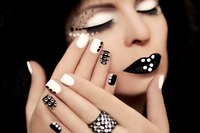 Choose   colored rhinestones that  contrast with your polish   for a dramatic look.