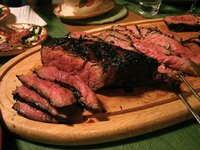 London broil is a long, flat cut of beef, grilled and served in thin slices.